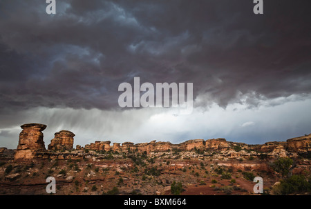 Threatening storm clouds over the Needles District of Canyonlands National Park, Utah, USA. - Stock Photo