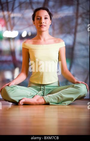 young girl doing yoga lotus pose stock photo royalty free