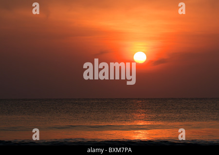 Golden Sunrise over the Indian Ocean at Nilaveli near Trincomalee on Sri Lanka's East Coast. - Stock Photo