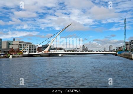 Samuel Beckett Bridge over River Liffey in Dublin Ireland - Stock Photo