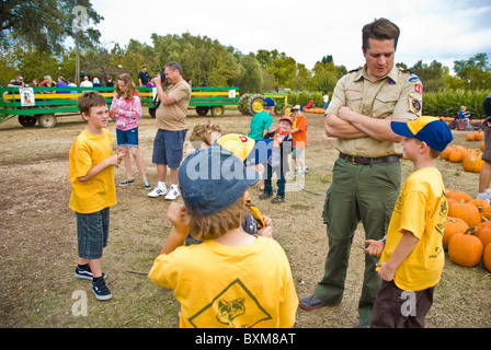 Cub Scouts on a field trip to a pumpkin farm - Stock Photo
