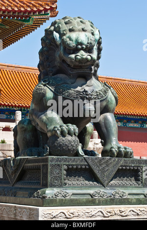 Asia, China, Beijing. Sculpture of male lion, one of traditional imperial guardian pair; Forbidden City. - Stock Photo