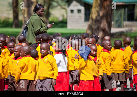 Class of schoolchildren on a field trip to Amboseli National Park in Kenya - Stock Photo