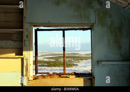 Winter view out the window of an old derelict shieling on the Isle of Lewis in the Western Isles - Stock Photo
