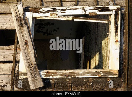 Window and wall of an old derelict wooden hut (shieling) on the isle of Lewis - Stock Photo