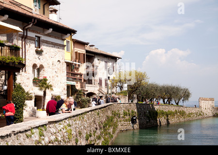 Lake-side street in the little town of Sirmione Italy on Lake Garda - Stock Photo