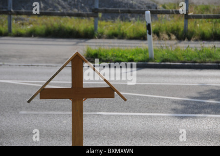Cautionary cross at the accident site - Stock Photo