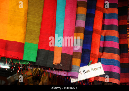 Brightly colored silk scarves on sale in Siem Reap market, Cambodia - Stock Photo