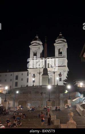 Rome, Italy. Nocturne view of Piazza di Spagna with Spanish steps, Trinità dei Monti and Obelisco Sallustiano - Stock Photo