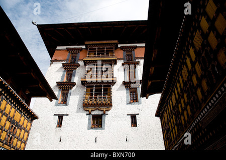 looking up to the monks' area within the walls of the Paro dzong, or fortress, in Bhutan - Stock Photo