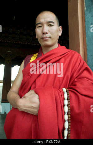 A senior Buddhist monk who is Master of Discipline to the monastic community in the Paro dzong, Bhutan - Stock Photo