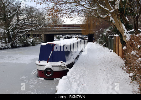 Grand Union Canal frozen in winter, Warwick, UK - Stock Photo