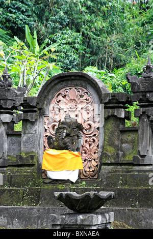 Statue of Ganesha, or Ganesh, at Pura Gunung Kawi Sebatu Temple, Tegallelang. Near Ubud. Bali, Indonesia - Stock Photo