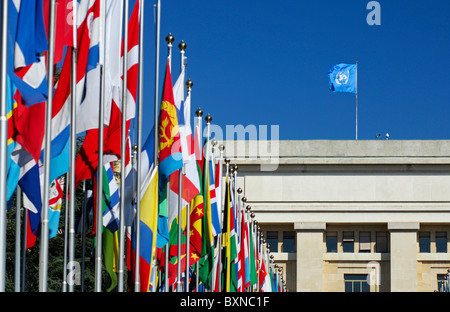 The blue United Nations flag and flags from all countries in the Court of Flags, United Nations,UN, Geneva, Switzerland - Stock Photo