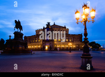 GERMANY Saxony Dresden Restored Baroque Sachsische Staatsoper or State Opera House in Theatre Square at sunset - Stock Photo