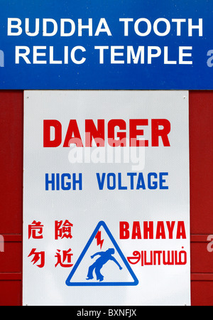 Singapore: warning sign on the Buddha Tooth Relic Temple in China Town - Stock Photo