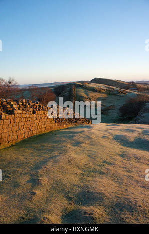 Hadrian's Wall at dawn on a frosty morning at Walltown Crags - Stock Photo