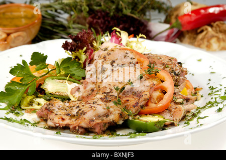 Grilled pork sirloin w tomato and bell peppers - Stock Photo