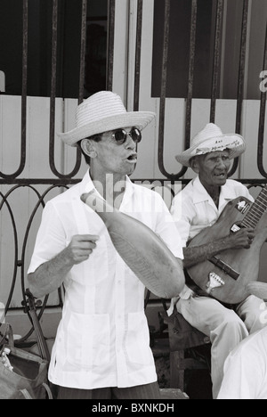 Musicians playing in streets of Havana. - Stock Photo