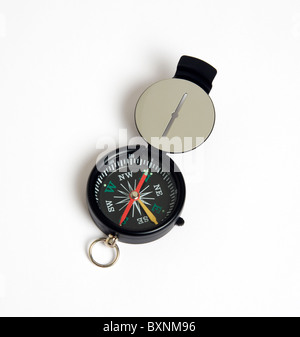 Travel, Navigation, Map Reading, Sighting compass with dial pointing to magnetic north on a white background. - Stock Photo
