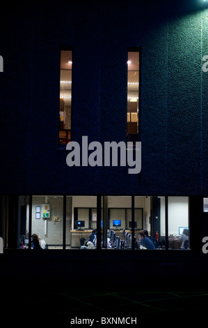 Students working in the library, Aberystwyth University, exterior, night, Wales UK - Stock Photo