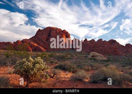 Evening clouds sweep over the sandstone landscape of Rainbow Vista in Nevada's Valley of Fire State Park. - Stock Photo