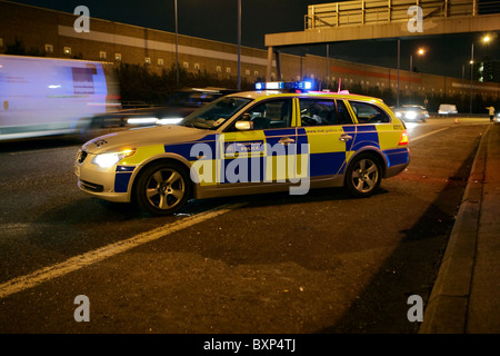 Police BMW patrol car - Stock Photo