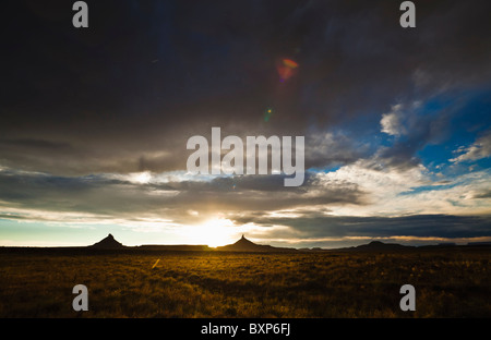 Rain falling from the sky as the sun sets over Canyonlands national Park in Southeast Utah, USA. - Stock Photo