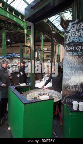 Take-away curry stall,Borough Food Market,London,England - Stock Photo