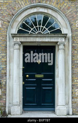 Traditional Black Front Door Of Redbrick House Kingsmead