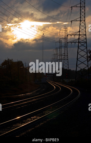 Sunset over railroad tracks in New Jersey, USA - Stock Photo