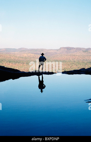 Man Standing Beside A Pool - Stock Photo