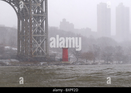 Windswept snow pummeled the Little Red Lighthouse at Jeffrey's Hook under the George Washington Bridge. Dec. 26, - Stock Photo