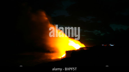 The lava flow from the Kilauea eruption on Hawaii's big island flowing into the Pacific and creating new land at - Stock Photo