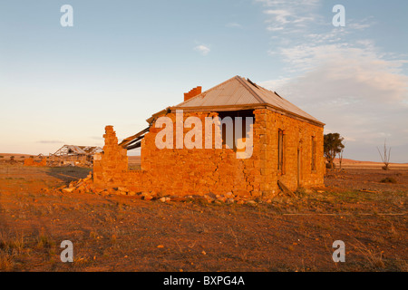 Sunset at the ruined Sambell's House near Peterborough, South Australia - Stock Photo