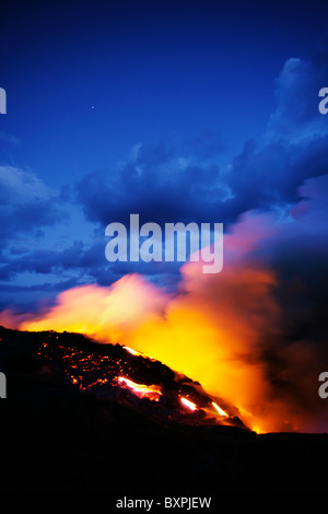 The lava flow from the Kilauea eruption on Hawaii's big island flowing in to the Pacific and creating new land at - Stock Photo