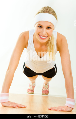 Image of young attractive woman doing physical exercise - Stock Photo