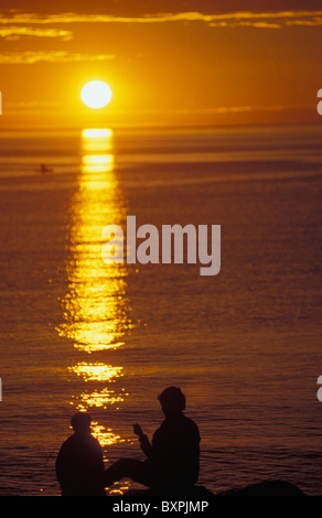 Mother And Son On Banks Of Saint Lawrence River At Sunset - Stock Photo