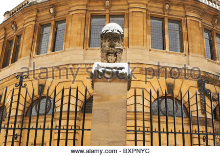 The Sheldonian Theatre and Clarendon Building in Oxford in Winter in the snow - Stock Photo