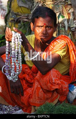 Indian Market Trader selling garlands, Calcutta, India