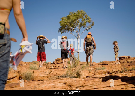 Family Hiking On Sandstone Rocks In Kings Canyon - Stock Photo