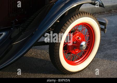 antique automobile wheel - Stock Photo