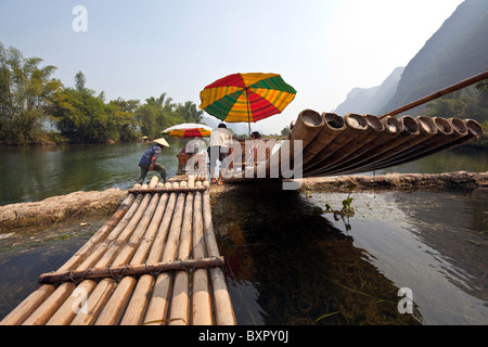 China, Guangxi Province, Yangshuo. Rafting on the Jade Dragon River. - Stock Photo