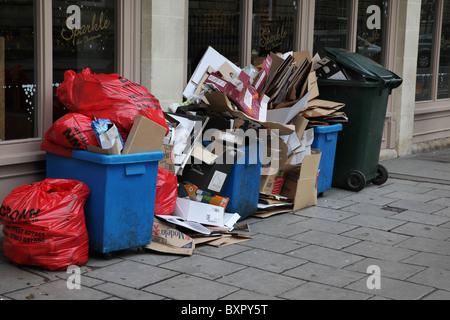 Rubbish outside a bar in Bath awaiting collection, UK - Stock Photo