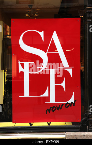 Bright red Sale sign in a shop window after Christmas, Bath, UK - Stock Photo