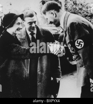 DUKE AND DUCHESS OF WINDSOR are greeted by Adolf Hitler in 1937 - Stock Photo