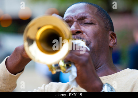 Street musician playing a trumpet in Washington DC - Stock Photo