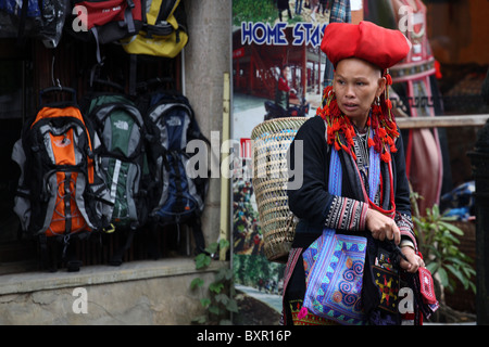 Red Zao ethnic minority hill tribe lady walking the streets in Sapa, north Vietnam - Stock Photo