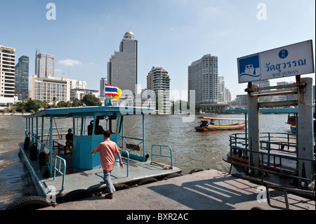 The Chao Phraya river is the royal river cutting through Bangkok and full of different types of boats and other - Stock Photo
