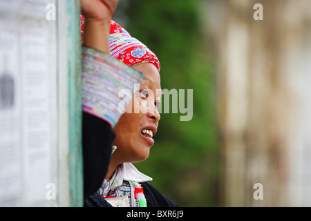 Red Zao hill tribe lady in Sapa, north Vietnam - Stock Photo